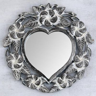Wall mirror, 'Black Frangipani Heart' - Suar Wood Hand Carved Heart Shaped Floral Wall Mirror