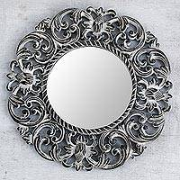 Wood wall mirror, 'Black Balsamina Buds' - Hand Carved Black Floral 15-Inch Wall Mirror from Bali