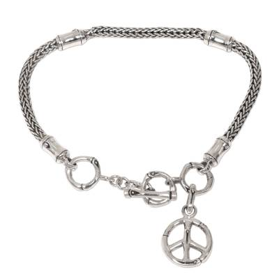 Artisan Crafted Sterling Silver Bracelet with Peace Charm