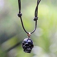 Bone pendant necklace, 'Black Skull' - Carved Bone Skull Pendant on Cord Handmade in Indonesia