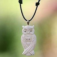 Bone and leather pendant necklace, 'White Owl Family' - Artisan Crafted Owl Family Pendant on Leather Cord Necklace