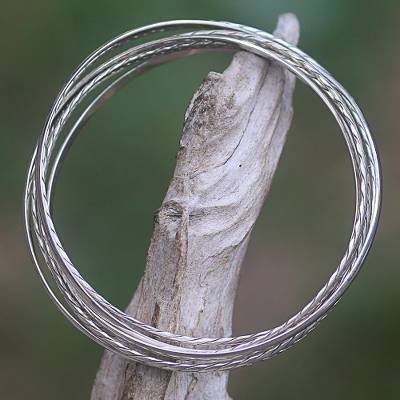 Sterling silver bangle bracelets, 'Entrancing Braid' (set of 6) - Artisan Crafted Sterling Silver Bangle Bracelets (Set of 6)