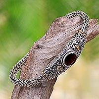 Gold accent garnet braided bracelet, 'Bedugul Garden' - Gold Accent Sterling Silver Artisanal Bracelet with Garnet
