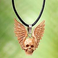 Bone pendant necklace, 'Flying Skull' - Hand Carved Bone Pendant Necklace of a Skull from Indonesia