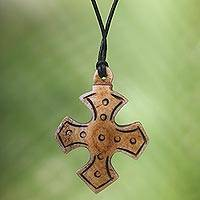 Bone pendant necklace, 'Sacred Bone' - Cross Bone Pendant Necklace with Leather Cord from Bali