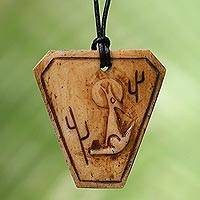 Bone pendant necklace, 'Coyote Song' - Carved Bone Pendant Necklace with Coyote Made in Indonesia