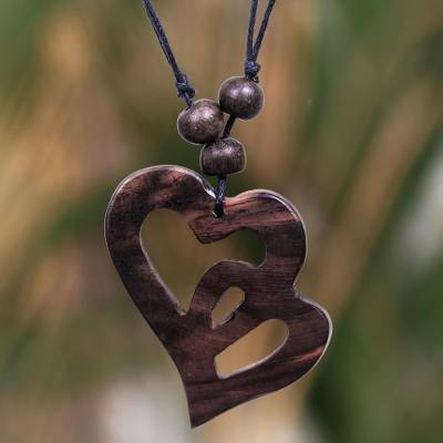 Wood pendant necklace, 'Two Hearts Entwined' - Artisan Crafted Heart Necklace in Sono Wood