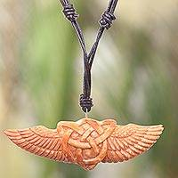 Bone pendant necklace, 'Celtic Wings' - Hand Carved Cow Bone Celtic Pendant Leather Cord Necklace