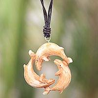 Bone and leather pendant necklace, 'Frolicking Whales' - Leather Necklace with a Hand Carved Bone Whale Pendant