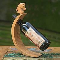Wood wine bottle holder, 'Brown Balinese Pony' - Horse Theme Carved Wood Wine Bottle Holder from Bali