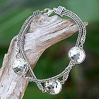 Sterling silver station bracelet, 'Brilliant Moons' - Hand Made Sterling Silver Naga Link Bracelet from Bali