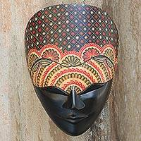 Wood batik mask, 'Face of Beauty and Calmness' - Artisan Crafted Wall Mask Adorned with Batik Flowers on Wood