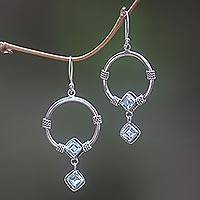 Blue topaz dangle earrings, 'Rings of Happiness in Blue' - Sterling Silver Blue Topaz Dangle Earrings from Indonesia