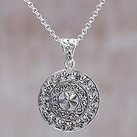 Sterling silver pendant necklace, 'Sacred Petals' - Hand Made Sterling Silver Floral Pendant Necklace Indonesia