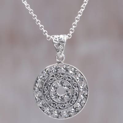 Sterling silver pendant necklace, 'Frangipani Altar' - Circular Floral Sterling Silver Pendant Necklace Indonesia