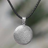 Sterling silver and leather pendant necklace, 'Silver Gong' - Sterling Silver Pendant Necklace on a Leather Cord