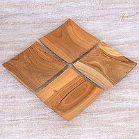 Teakwood appetizer plates, 'Sushi Delight' (set of 4) - Hand Carved Teakwood Plates (Set of 4) from Indonesia