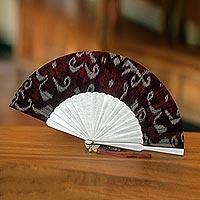 Cotton and mahogany wood fan,