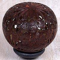 Coconut shell sculpture, 'Buddha's Lore' - Coconut Shell Sculpture on Stand with Buddha Carving