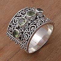 Peridot cocktail ring, 'Lucky Four' - Peridot and 925 Sterling Silver Multi-Stone Ring from Bali