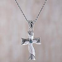 Blue topaz cross pendant necklace, 'Blue Faith' - Blue Topaz and Sterling Silver Cross Necklace from Bali
