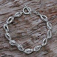 Men's sterling silver link bracelet, 'Shining Novas' - Sterling Silver Men's Link Bracelet from Indonesia