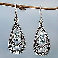 Blue topaz dangle earrings, 'Gleaming Teardrops in Blue' - Blue Topaz Teardrop Dangle Earrings from Indonesia