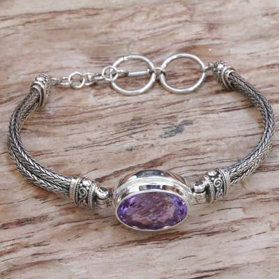 Amethyst pendant bracelet, 'Eye of Amlapura' - Sterling Silver and Amethyst Pendant Bracelet from Indonesia