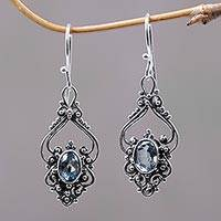Blue topaz dangle earrings, 'Sigh' - Bali Artisan Jewelry Blue Topaz Sterling Silver Earrings