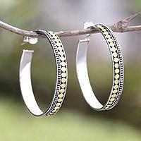 Gold accented sterling silver half-hoop earrings,