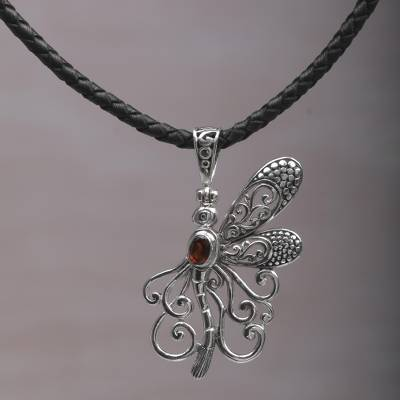 Garnet pendant necklace, 'Bali Dragonfly' - Garnet and Leather Dragonfly Pendant Necklace from Bali