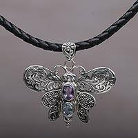 Amethyst and blue topaz pendant necklace, 'Bali Moth' - Amethyst and Blue Topaz Moth Pendant Necklace from Bali