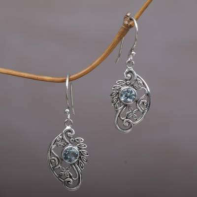 Blue topaz dangle earrings, 'Proud Swans' - Balinese Blue Topaz and Sterling Silver Swan Theme Earrings