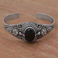 Onyx cuff bracelet, 'Balinese Magic in Black' - Onyx and Sterling Silver Floral Cuff Bracelet from Indonesia