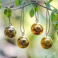 Wood ornaments, 'Golden Baubles' (set of 4) - Four Round Gold Tone Albesia Wood Ornaments from Bali