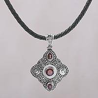 Garnet pendant necklace, 'Klungkung Majesty' - Garnet and 925 Sterling Silver Pendant Necklace from Bali