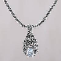Blue topaz pendant necklace, 'Patterns of the World' - Blue Topaz and Sterling Silver Pendant Necklace from Bali