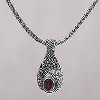 Garnet pendant necklace, 'Patterns of the World' - Garnet and Sterling Silver Drop Pendant Necklace from Bali