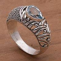 Blue topaz single stone ring, 'Two Souls' - Blue Topaz and Sterling Silver Single Stone Ring from Bali