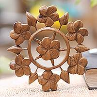 Wood relief panel, 'Frangipani Garden' - Hand Carved Floral Wood Wall Relief Panel from Indonesia