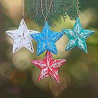 Wood ornaments, 'Multicolored Stars' (set of 4) - Four Multicolored Albesia Wood Star Ornaments from Bali