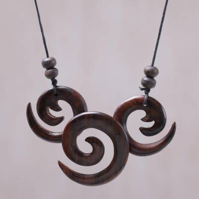 Wood pendant necklace, 'Windy Spirals' - Sono Wood Adjustable Spiral Pendant Necklace from Bali