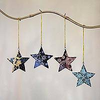Batik wood ornaments, 'Bali Stars' (set of 4) - Four Batik Wood Star Ornaments by Balinese Artisans