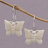 Bone dangle earrings, 'Floating Butterflies' - Handcrafted Bone Butterfly Dangle Earrings from Bali