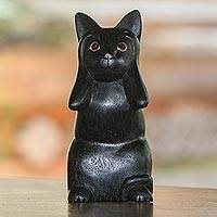 Wood sculpture, 'Kitty Hears No Evil' - Hand-Carved Black Suar Wood Cat Sculpture from Bali