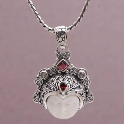 Garnet and rainbow moonstone pendant necklace, 'Diamond Warrior' - Garnet and Sterling Silver Face Pendant Necklace from Bali