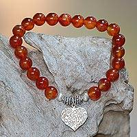 Carnelian beaded stretch bracelet, 'Loving Fantasy' - Red Carnelian Heart Charm Beaded Bracelet from Bali