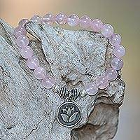 Rose quartz beaded stretch bracelet, 'Lotus Burst' - Rose Quartz and Lotus Charm Beaded Bracelet from BAli