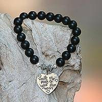 Onyx beaded stretch bracelet, 'Path of Love in Matte' - Black Onyx and Heart Charm Beaded Bracelet from Bali