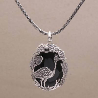 Onyx pendant necklace, 'Mother Heron' - Onyx and Sterling Silver Bird-Themed Necklace from Bali
